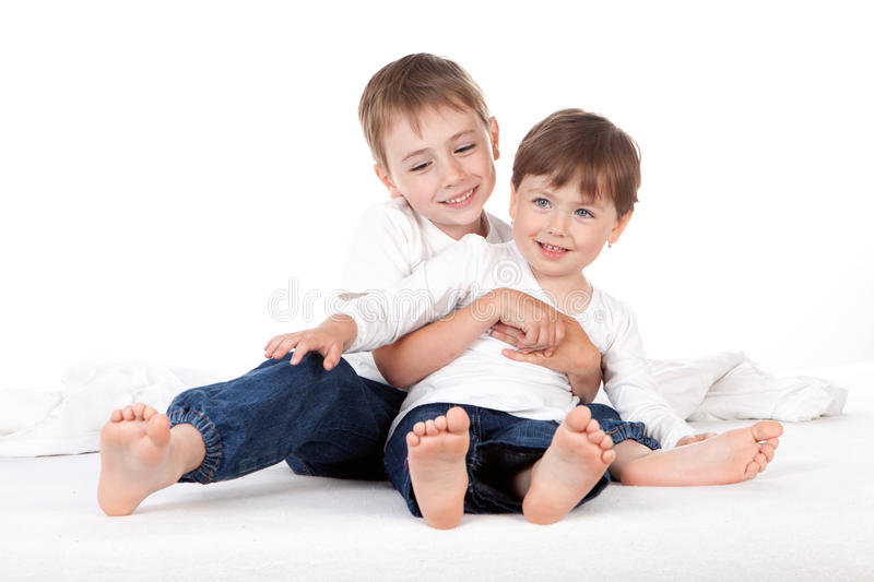 Boy and girl on bed royalty free stock photography
