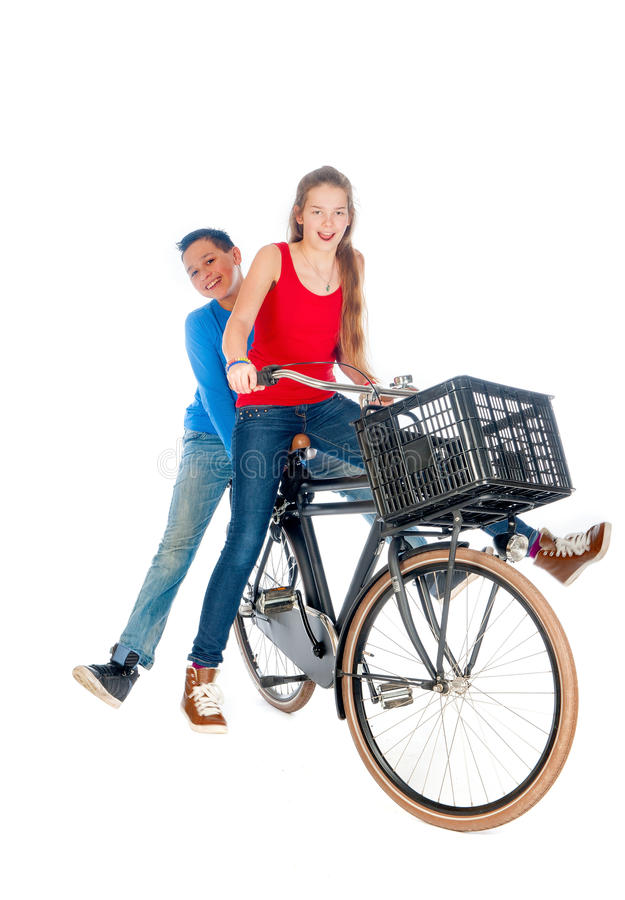 Boy and a girl on a bike stock photo