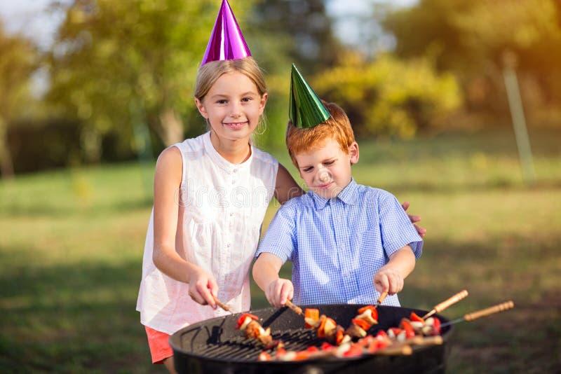 Boy and girl celebrating birthday stock photo