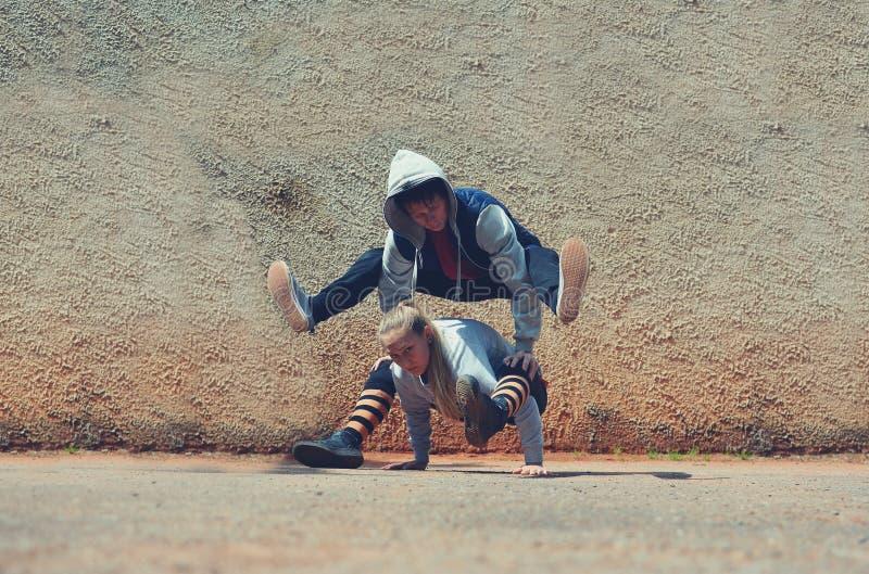 Boy and girl dancing break dance on the street. Boy and girl dancing break dance in the street stock photo