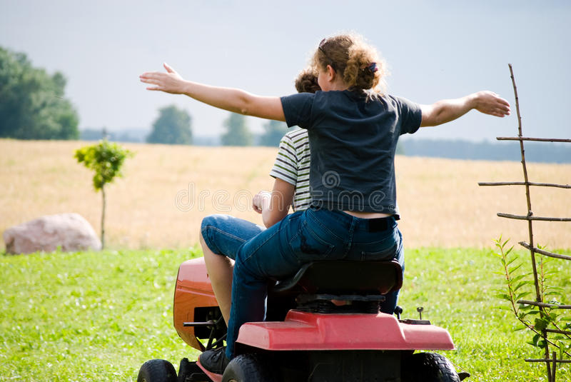 Download Boy And Girl Enjoy Driving A Tractor Stock Photo - Image of machinery, enjoy: 20578920
