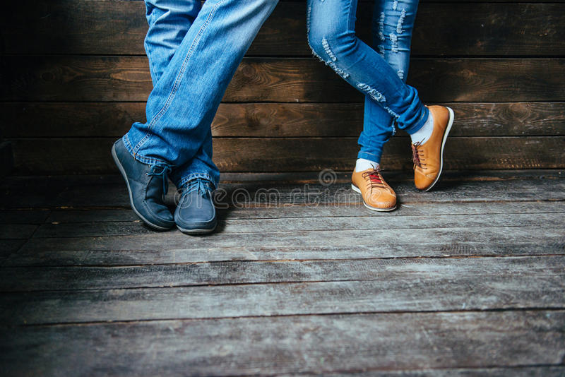 Boy and girl feet in shoes royalty free stock photo