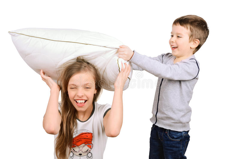 Boy and girl fighting pillow stock photos