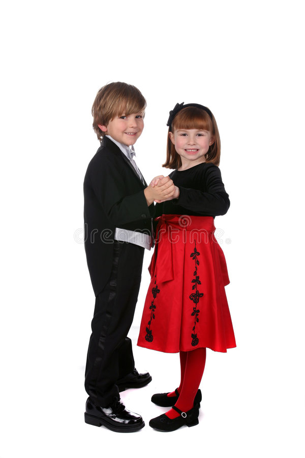 Boy and girl in formal clothing dancing together stock images