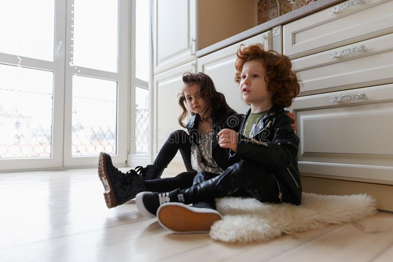 Boy and girl friends sit together on the floor royalty free stock photos