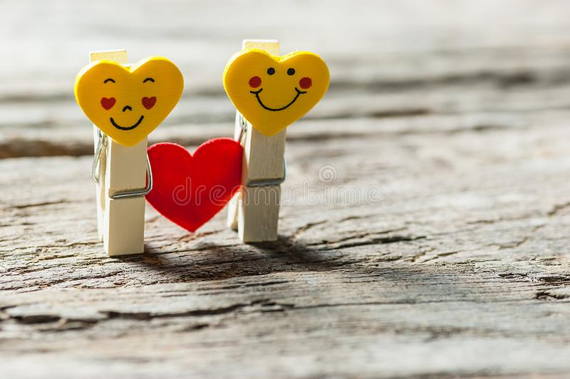 Boy and girl heart yellow emoticons with love. Happy valentines day. St. Valentine concept. Holidays greeting card copy space royalty free stock photography
