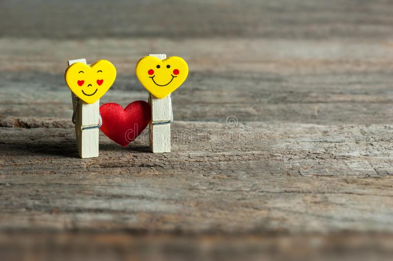 Boy and girl heart yellow emoticons with love. Happy valentines day. St. Valentine concept. Holidays greeting card copy space stock image