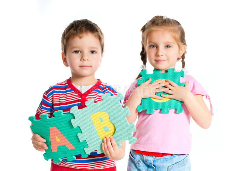 Boy and girl holding letters stock photography