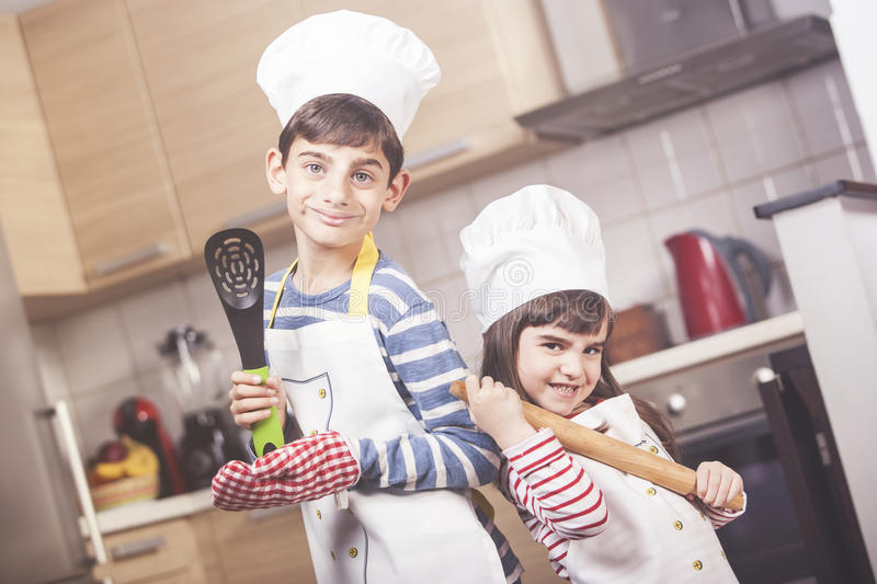 Boy and girl in the kitchen royalty free stock photography