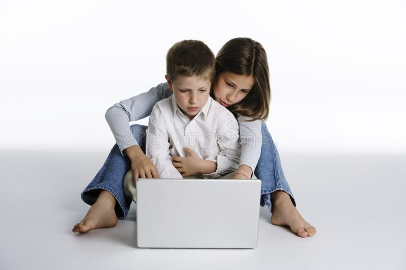 Boy and girl with laptop computer royalty free stock photography