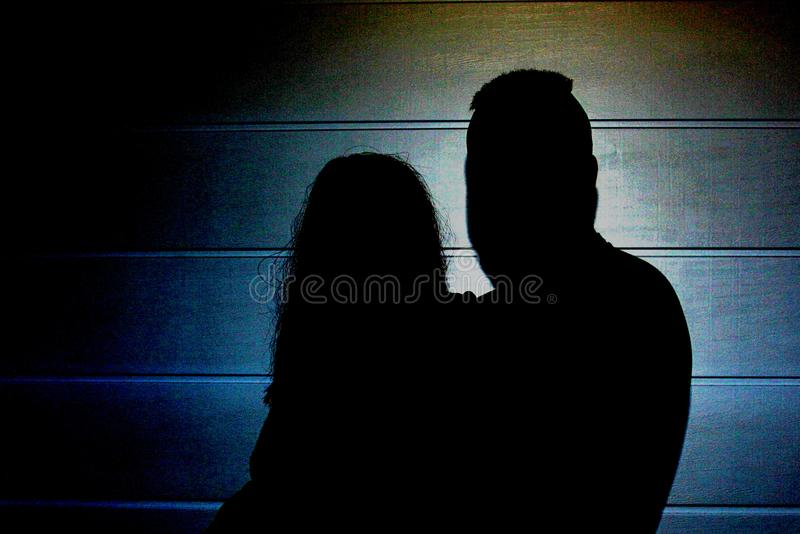 The couple in the dark royalty free stock photo