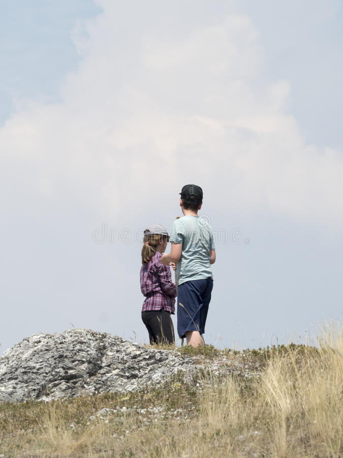 Boy and girl outdoors in the mountains royalty free stock images