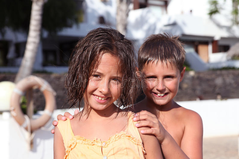 Boy and girl playing stock photos