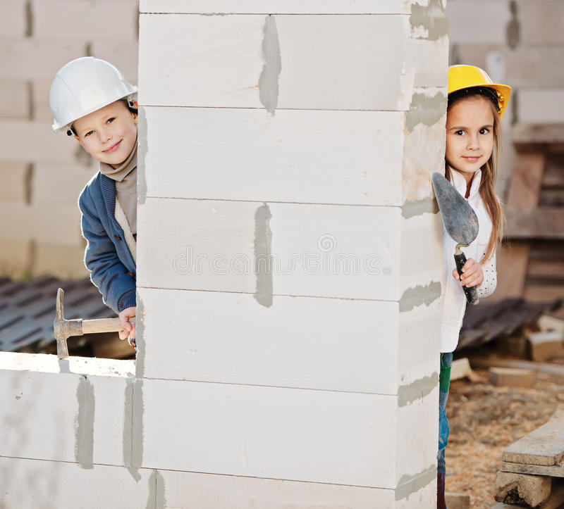 Boy and girl playing on construction site royalty free stock images