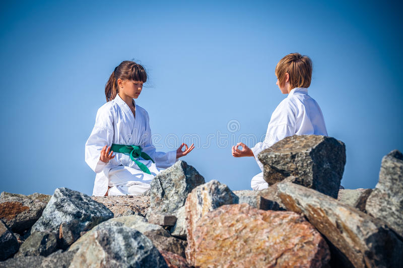 Download Boy And Girl Practising Yoga On Beach Royalty Free Stock Photo - Image: 33439595