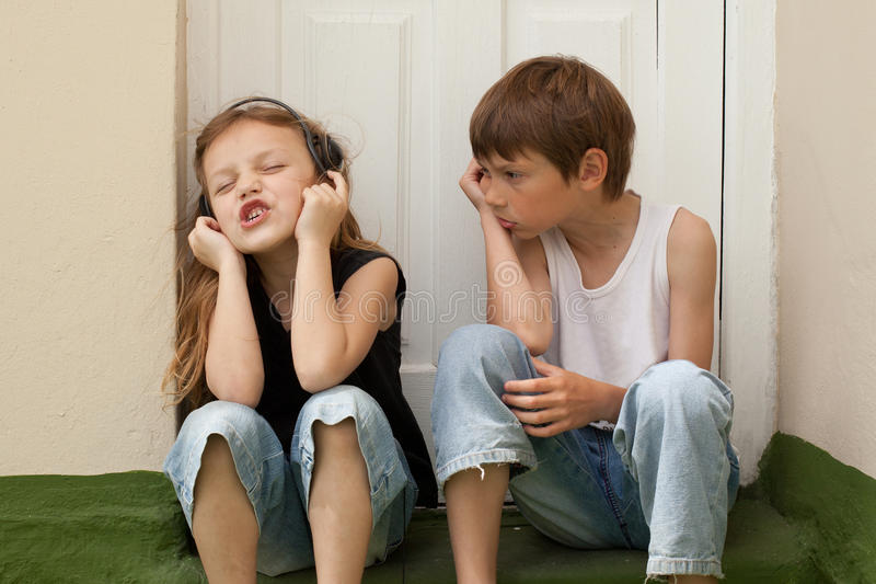 A boy,a girl,and rock and roll stock photos