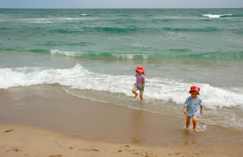 Download Boy And Girl Running From Ocean Surf Stock Photo - Image of friendship, blue: 5383238