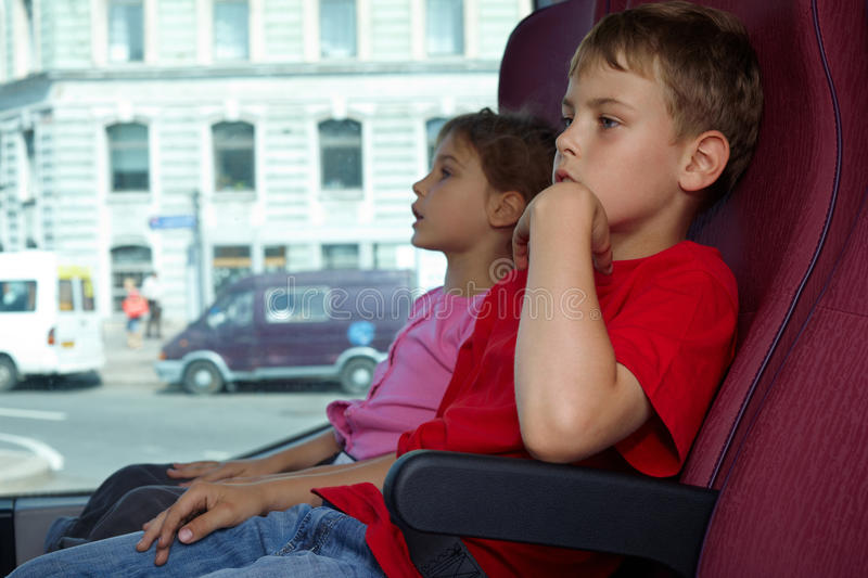 Download Boy And Girl Sit In Chairs In Bus Stock Image - Image: 26281695