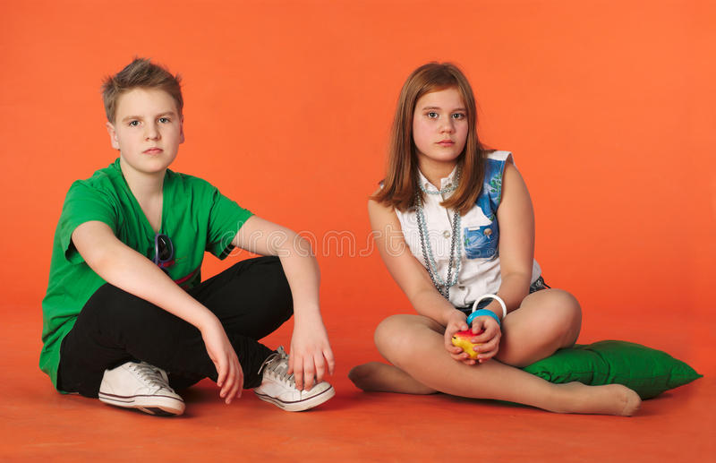 Download Boy And Girl Sitting On The Floor Royalty Free Stock Images - Image: 19335909