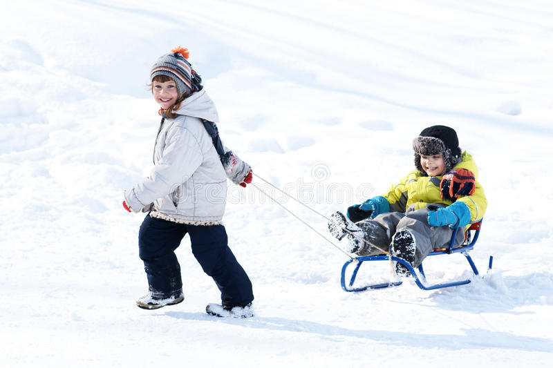 Download Boy and girl with sled stock photo. Image of cold, playful - 19302418