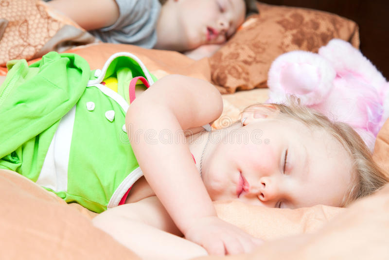 Boy and girl sleeping royalty free stock photography