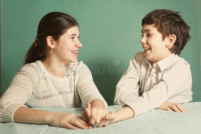 Boy and girl srtugglig arm wrestling. Teen siblings boy and girl srtugglig arm wrestling close up photo royalty free stock image