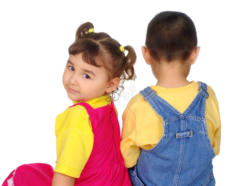 Boy and girl together, girl looking back stock photos