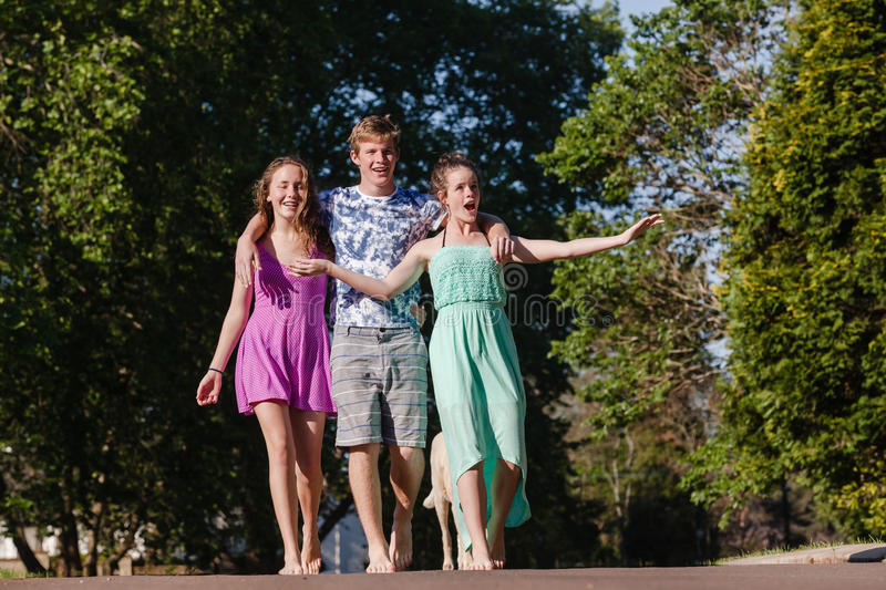 Boy Girls Walking Talking Laugh royalty free stock photo