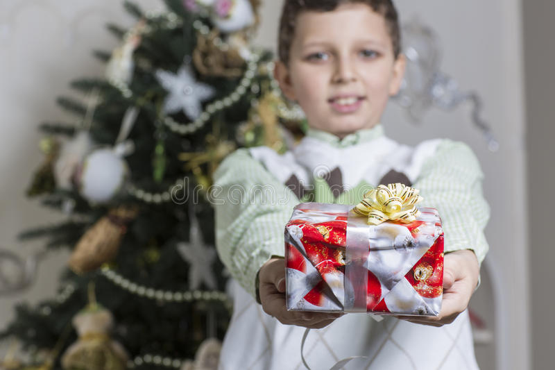 Boy Gives Christmas Gift Stock Images