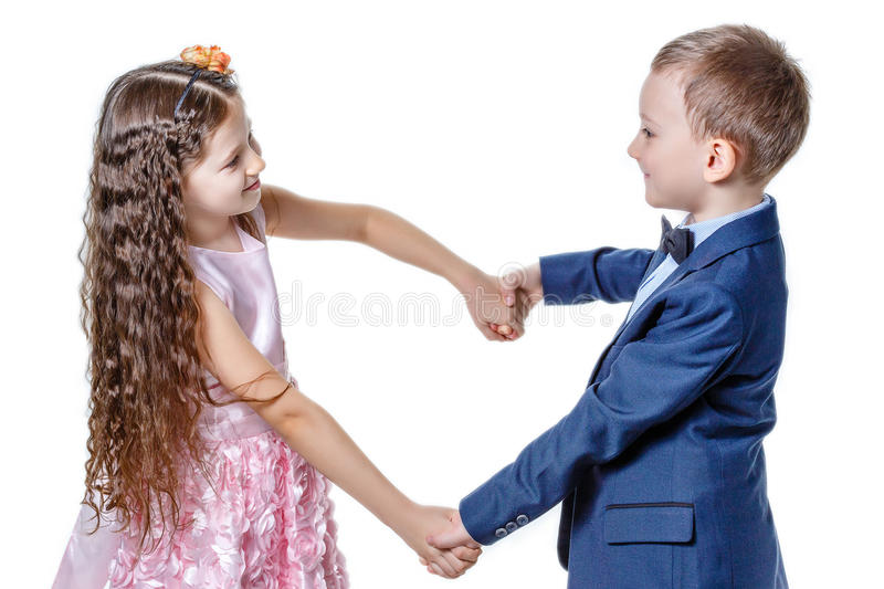 Boy gives a girl flowers on the day of St . Valentine stock image
