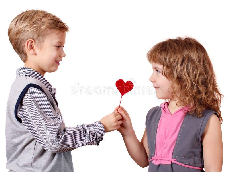 Boy Gives A Little Girl Heart Royalty Free Stock Photos