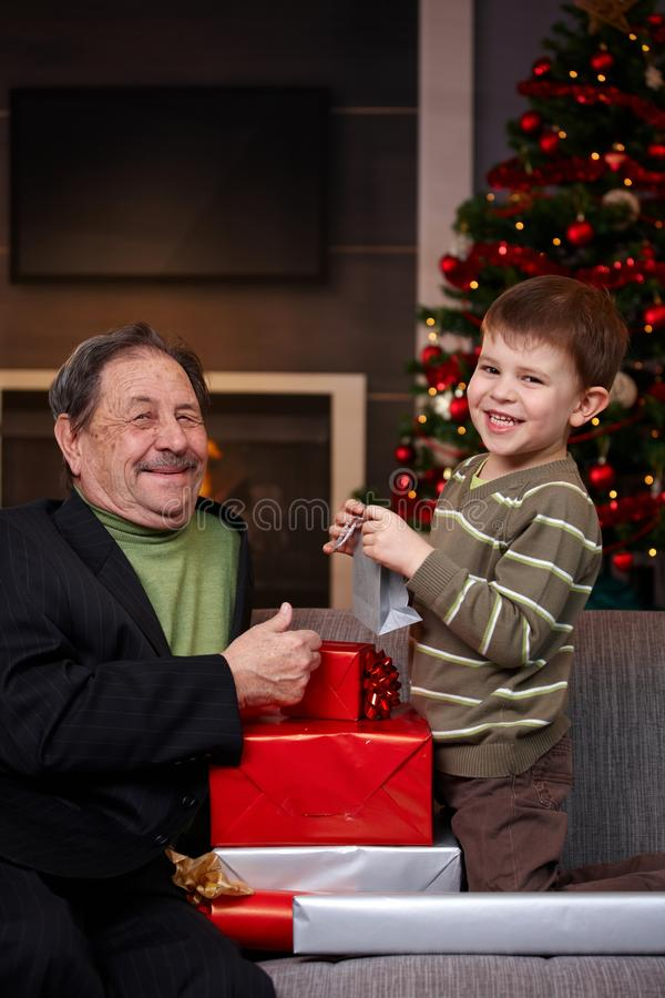 Download Boy Giving Christmas Present To Grandfather Stock Image - Image: 34462005