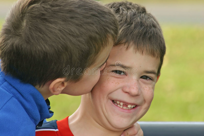 Boy giving kiss on cheek stock image