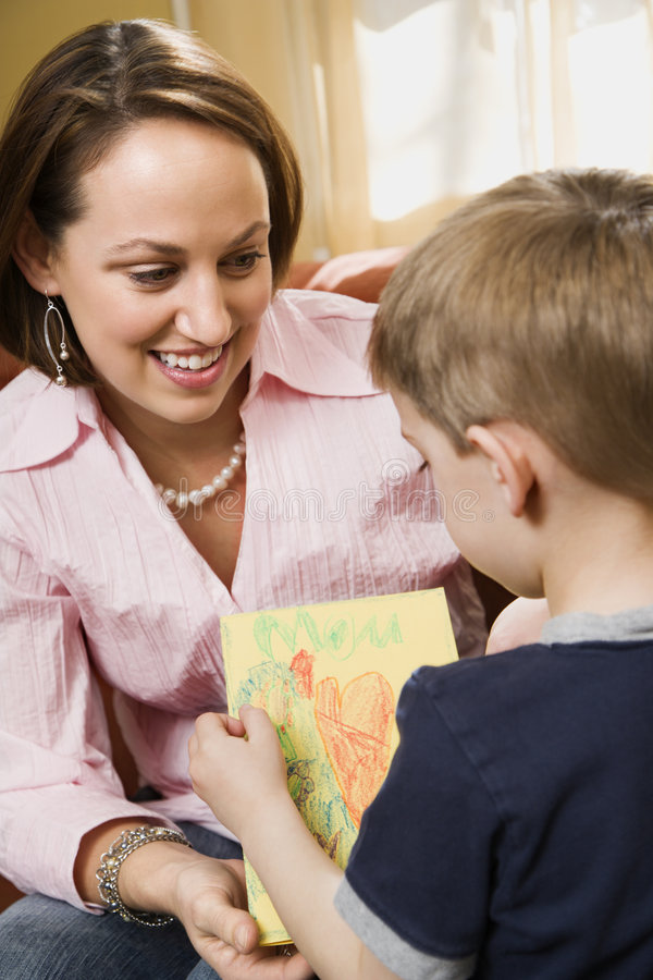 Boy giving mom a drawing. royalty free stock photos