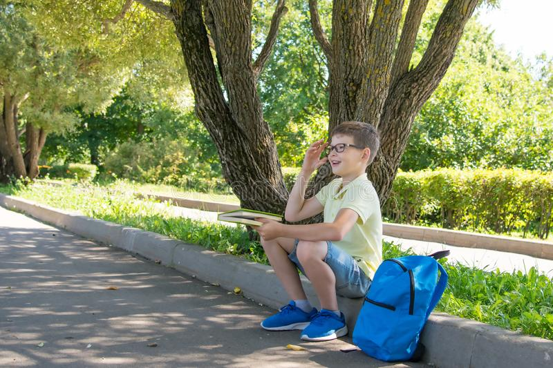 Boy in glasses, on the street, thinking about school stock photos