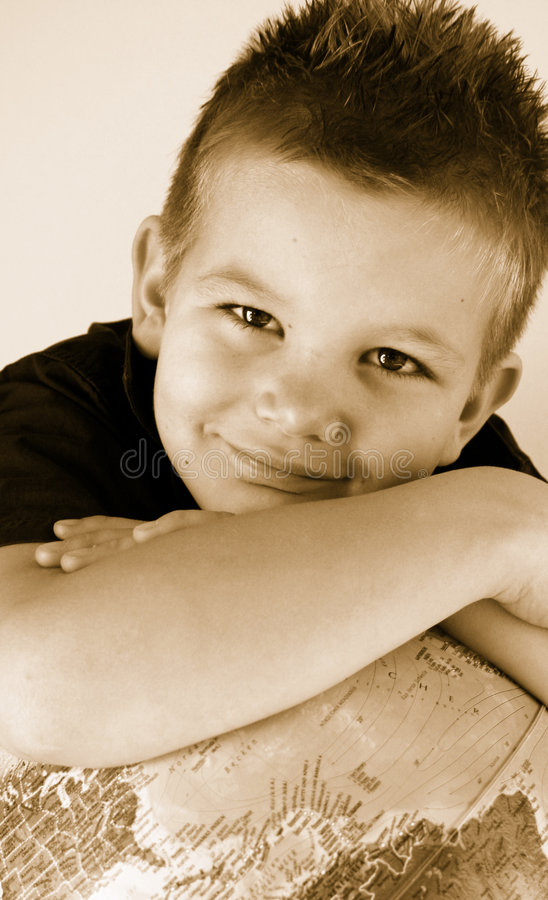 Boy with globe. Boy is holding the world in his hands royalty free stock photos