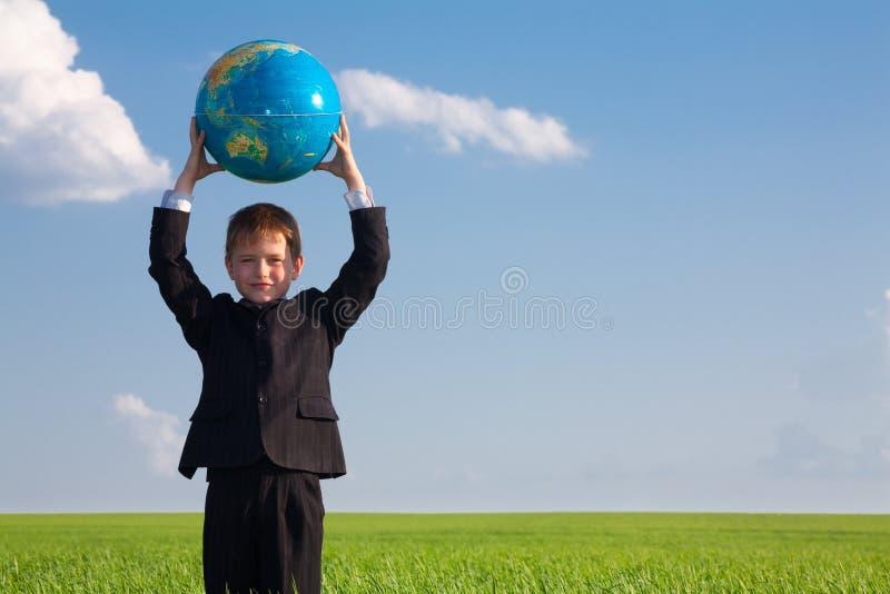 Boy with globe stock photos