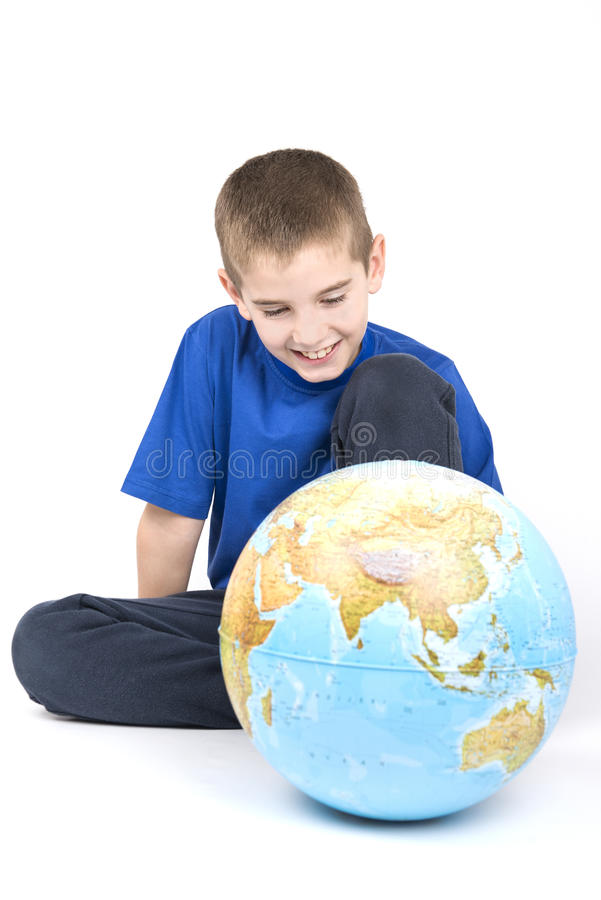 Boy and globe royalty free stock images