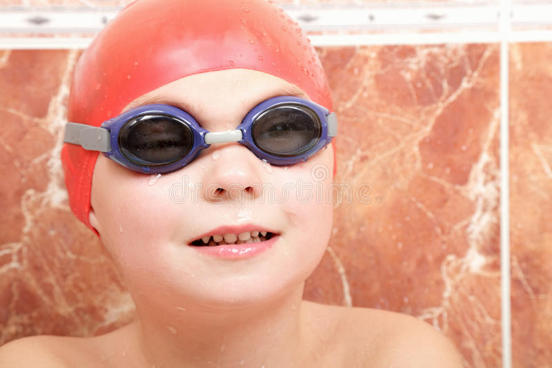 Boy in goggles and cap. Little boy in goggles and red rubber cap stock photos
