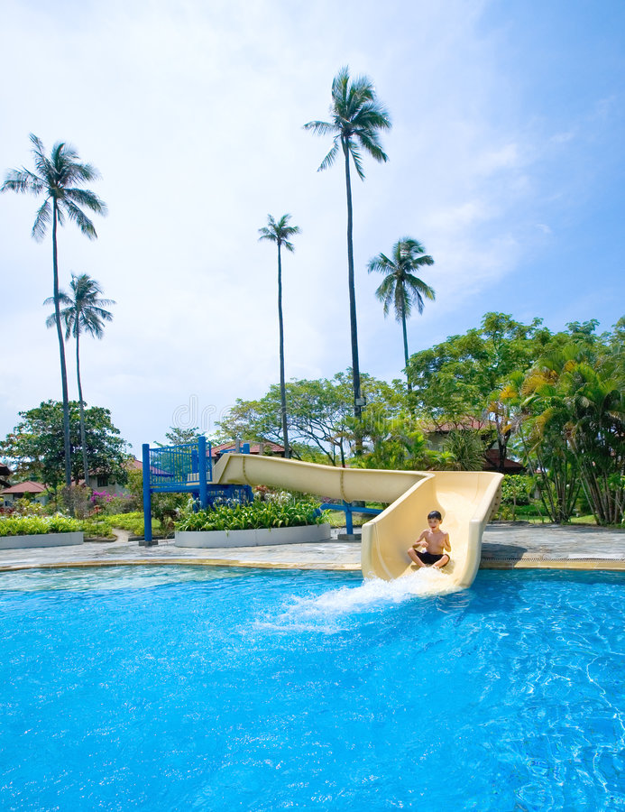 Download Boy Going Down The Slide At Swimming Pool Stock Photos - Image: 8212543