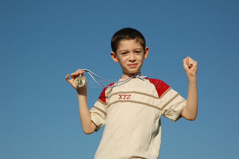Boy with gold medal stock photography