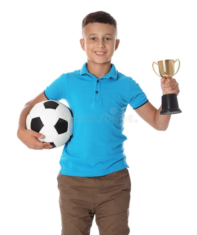 Boy with golden winning cup and soccer ball on white background. Happy boy with golden winning cup and soccer ball on white background royalty free stock images
