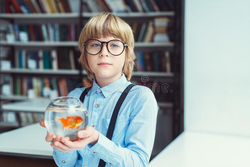 Boy with goldfish stock photo