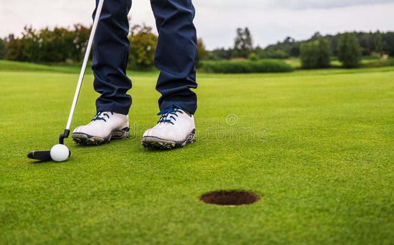 Golf hit on green stock images