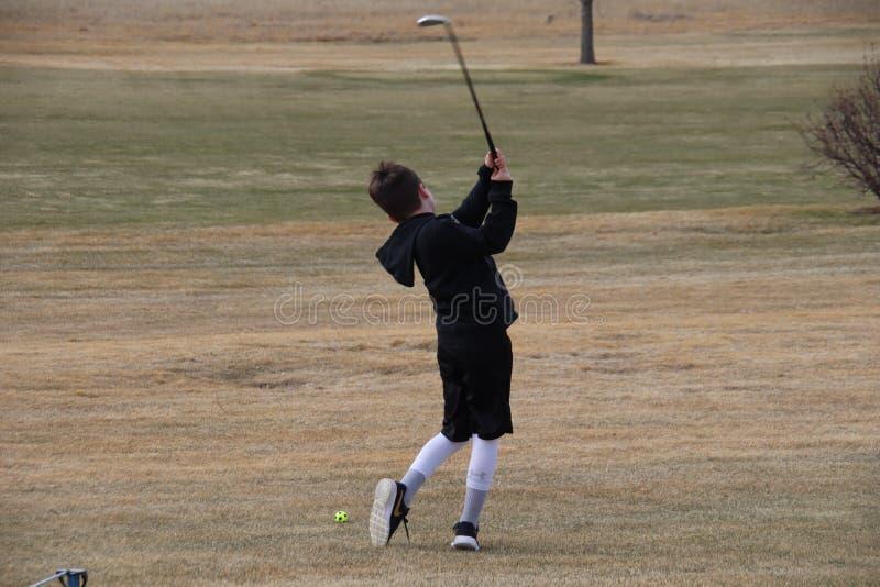 Boy golfing royalty free stock photos