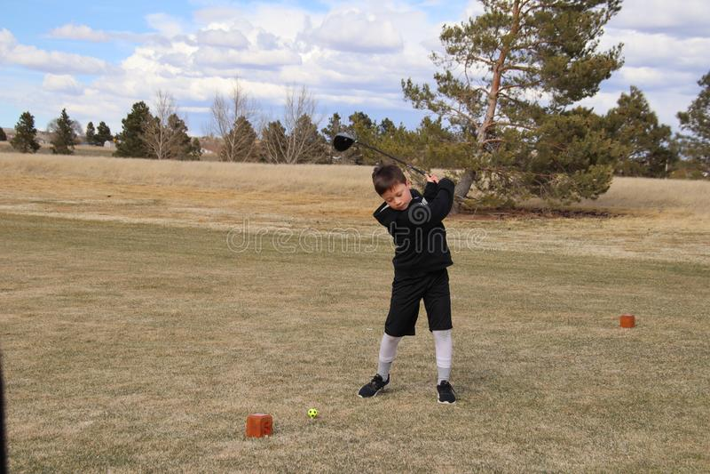 Boy golfing royaltyfria foton
