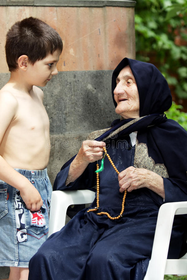Boy and granny stock image. Image of sunlight, rosary