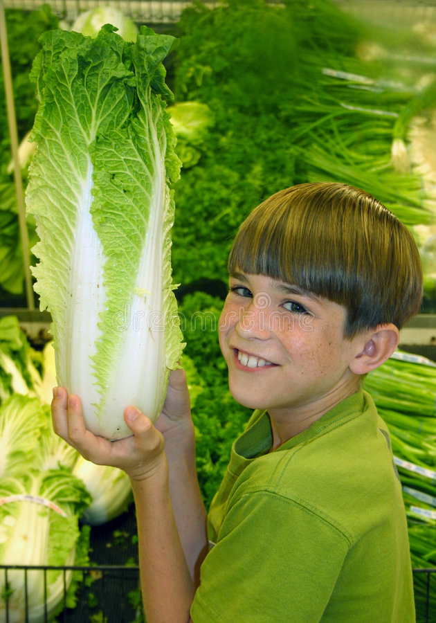 Boy in Grocery Store. Boy in produce department in the grocery store royalty free stock photography
