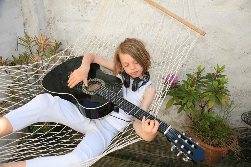 Download Boy and guitar stock photo. Image of young, play, relax - 16392184