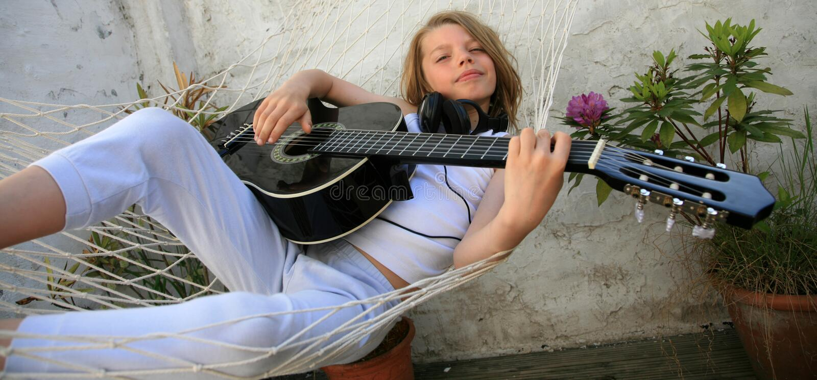 Download Boy and guitar stock image. Image of listen, hammock - 16392199